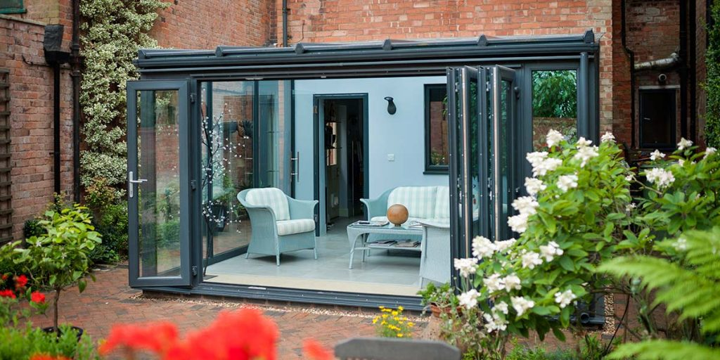 Grey Lean-To Conservatory with Bi-Folding Doors